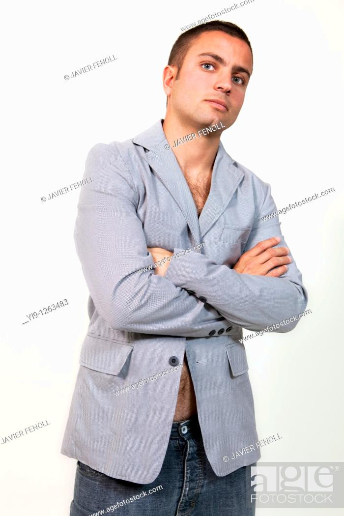 Stock Photo: Young man wearing suit jacket and no shirt.