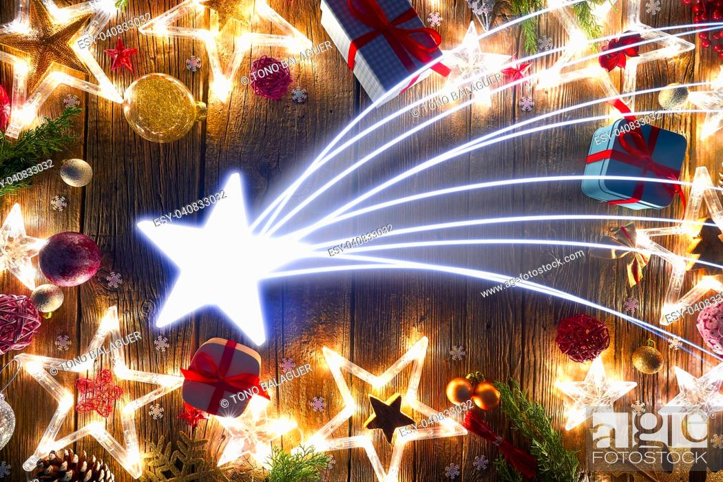 Stock Photo: Christmas star comet postcard vintage on wooden background.