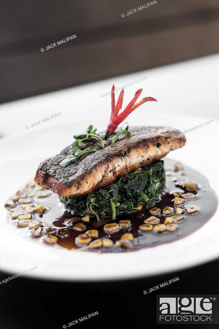 Stock Photo: salmon fillet with steamed spinach and corn with sweet soy and oyster sauce.