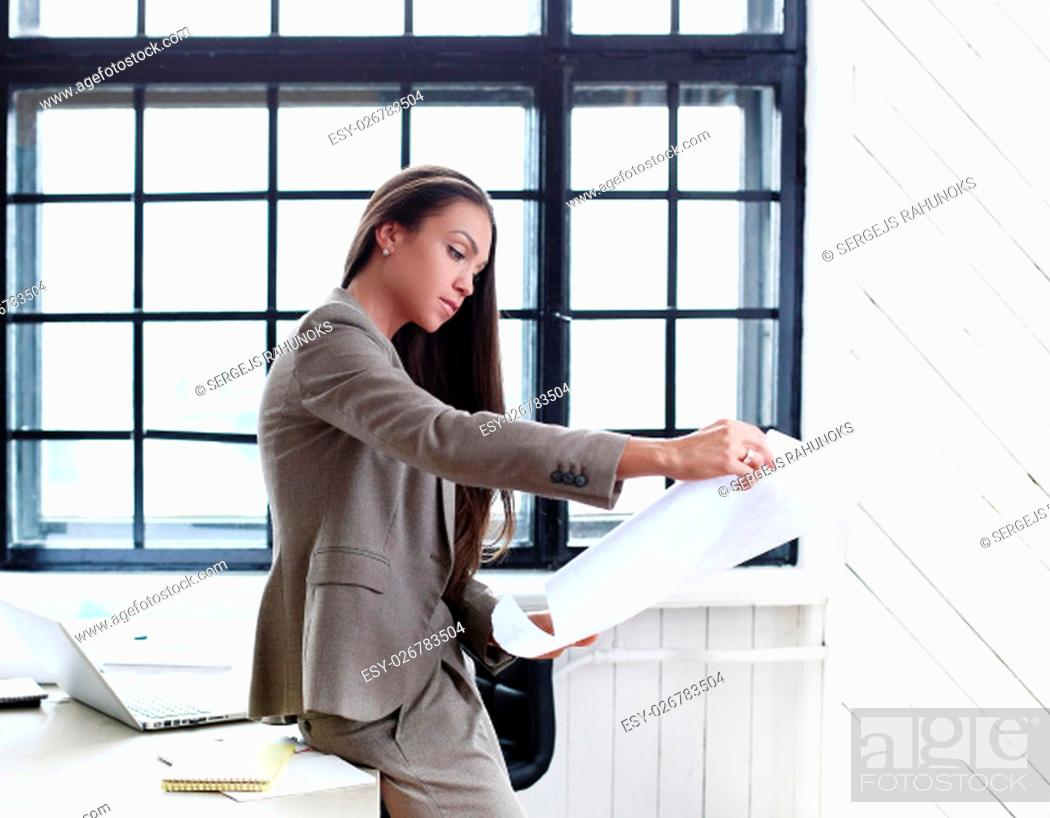 Stock Photo: Business woman in the office.