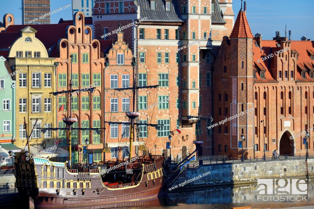 Stock Photo: Gdansk Poland. Old Town centre. Dlugie Pobrzeze and Mariacka Gate frontage on the Motlawa River tourist area. Summer morning.