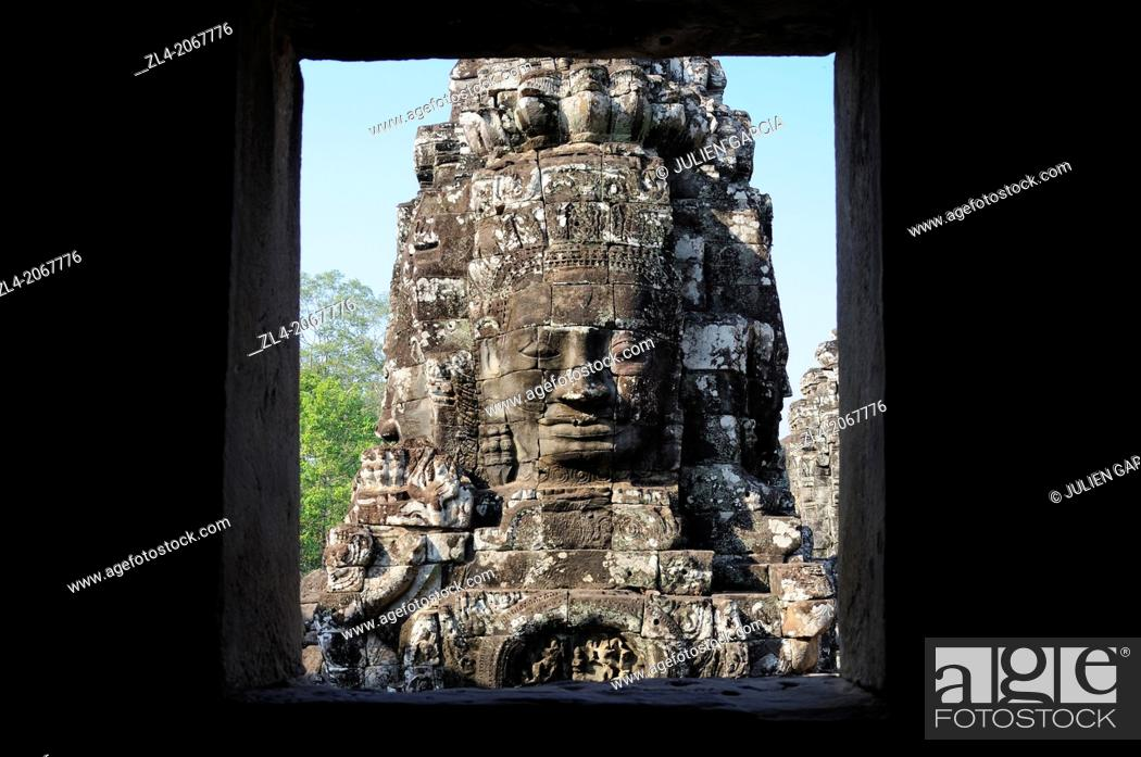 Stock Photo: Enigmatic Lokesvara stone faces on the towers of the Bayon temple, Angkor Thom. Cambodia, Siem Reap, Angkor.