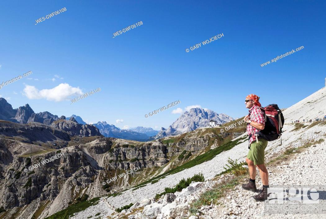 Stock Photo: Hiker on hiking trail, Tre Cime di Lavaredo Aera, Nature Park Tre Cime, Unesco World Heritage Natural Site, Sexten Dolomites, Italy.