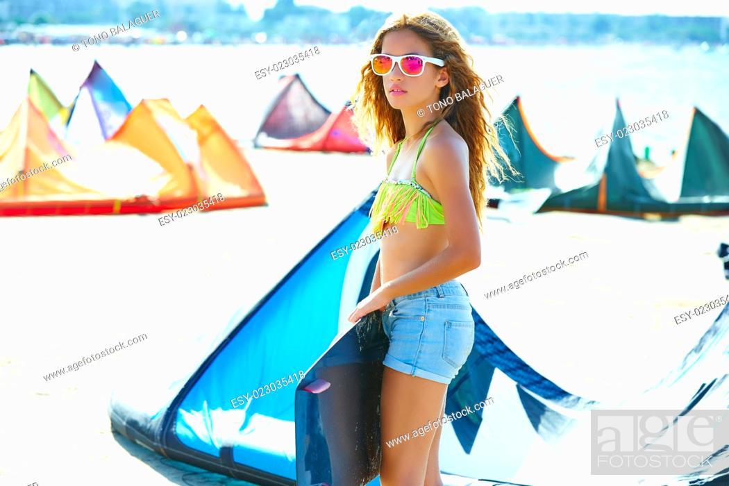 Imagen: Blond kite surf teen girl in summer beach at Mediterranean.