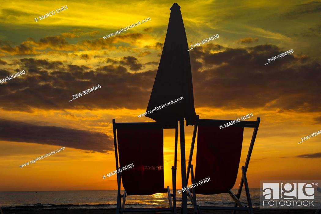 Imagen: Chair on the beach seen at the sunset of the winter sea.