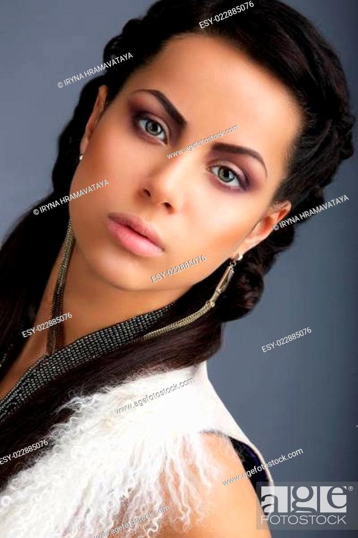 Stock Photo: Fascination. Face of Young Nice Looking Brunette with Earrings.