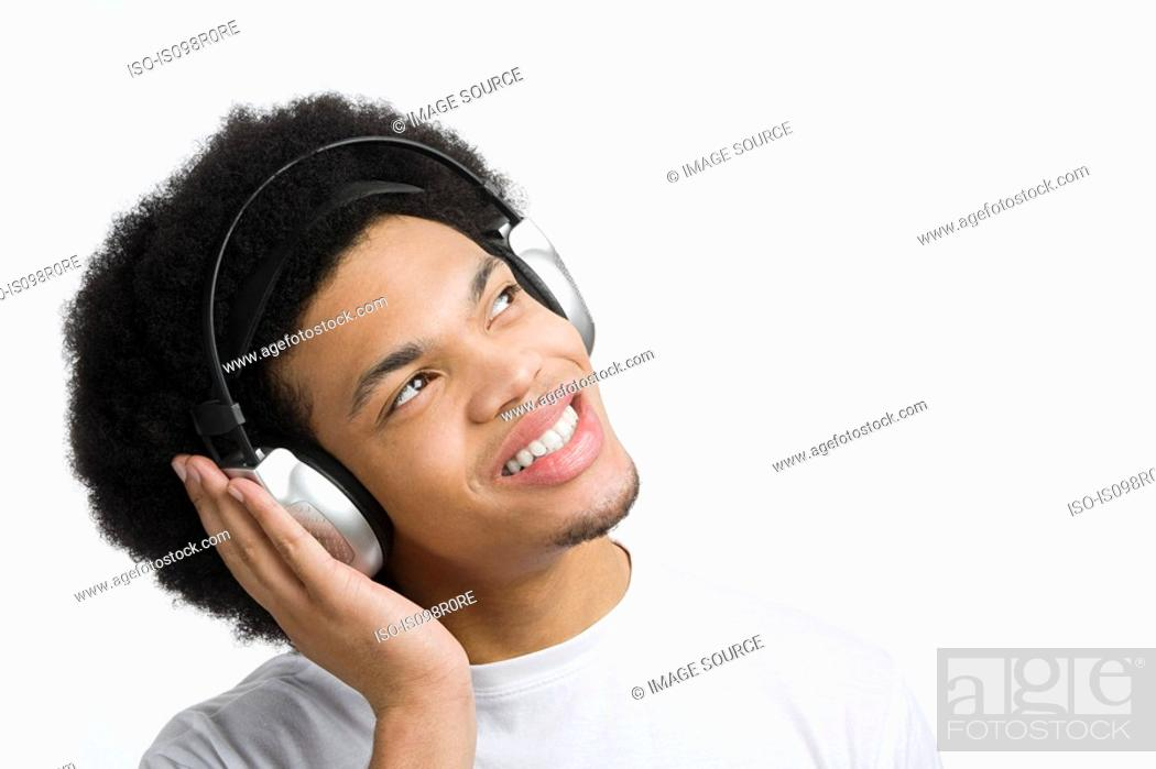 Stock Photo: A young man listening to music.