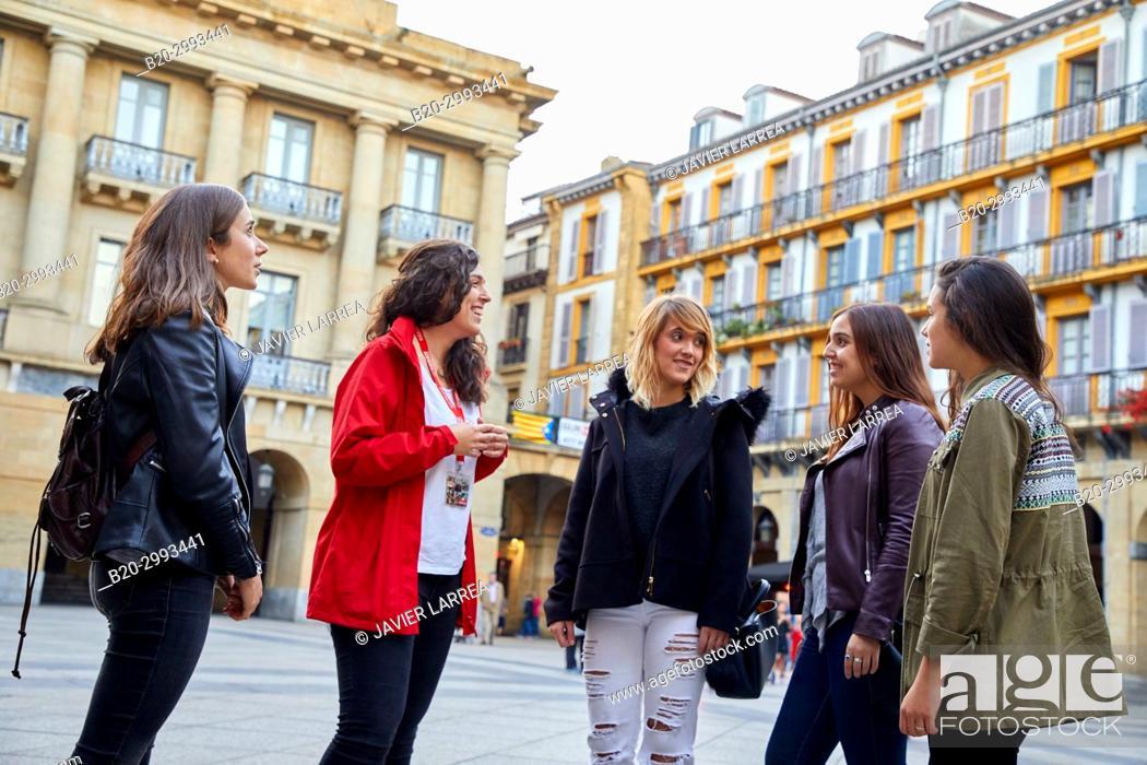 Stock Photo: Group of tourists and guide making a tour of the city, Plaza de La Constitución, Old Town, Donostia, San Sebastian, Gipuzkoa, Basque Country, Spain, Europe.