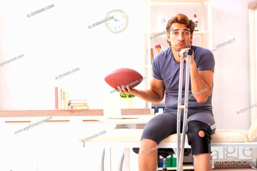 Stock Photo: Handsome american footbal player visiting female doctor traumatologist.
