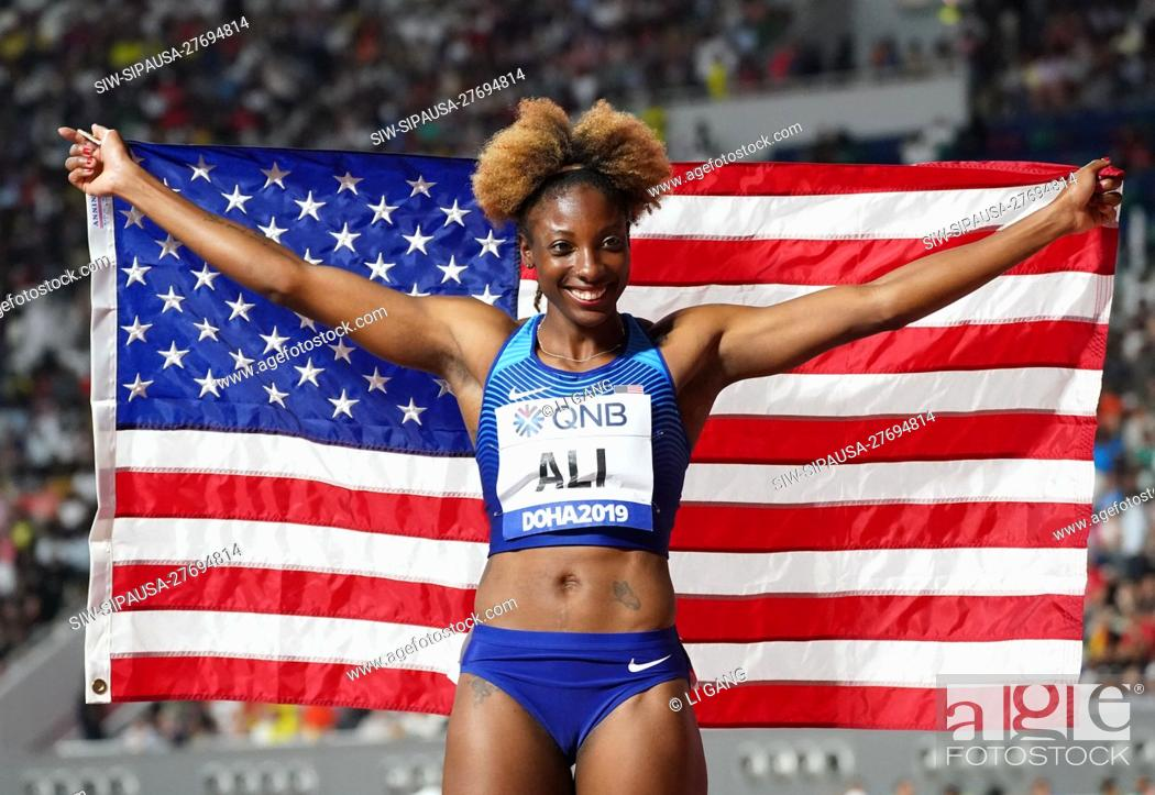 Stock Photo: (191007) -- DOHA, Oct. 7, 2019 (Xinhua) -- Nia Ali of the United States celebrates after the women's 100m hurdles at the 2019 IAAF World Athletics Championships.