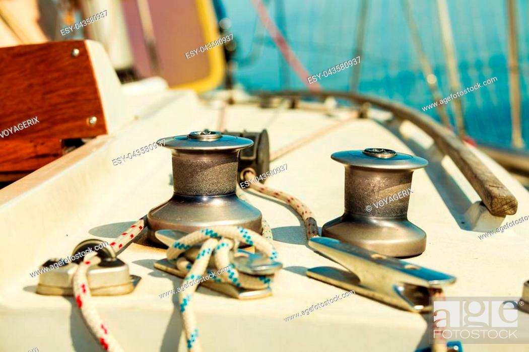 Stock Photo: Yacht capstan with rope on sailing boat during cruise, marine objects concept.