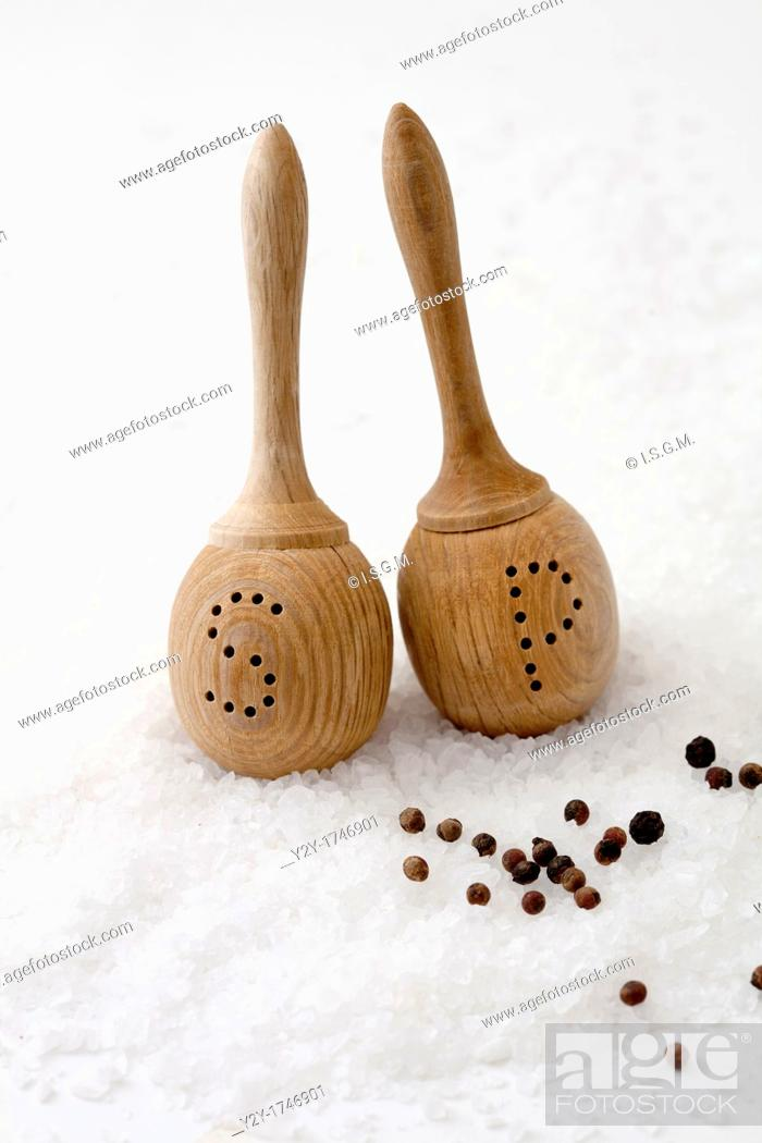 Stock Photo: Salt and pepper wooden shakers on salt and pepper balls.