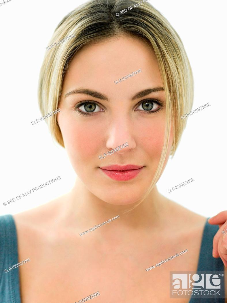 Stock Photo: Portrait of young woman in bathroom.