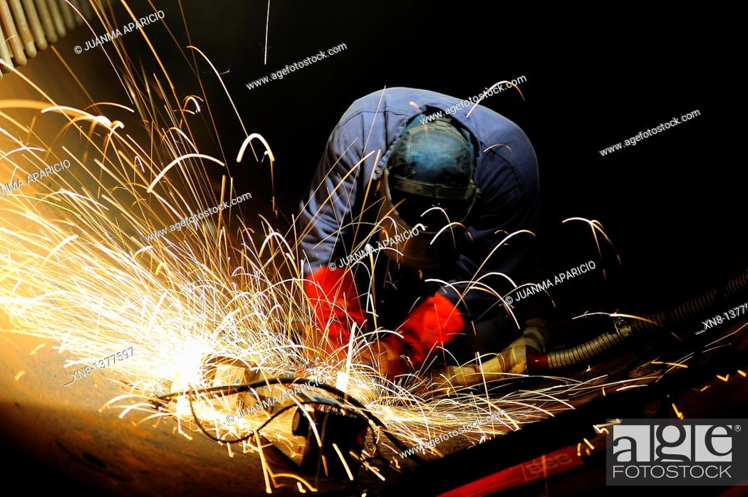 Stock Photo: Metallurgical industry worker grinding.