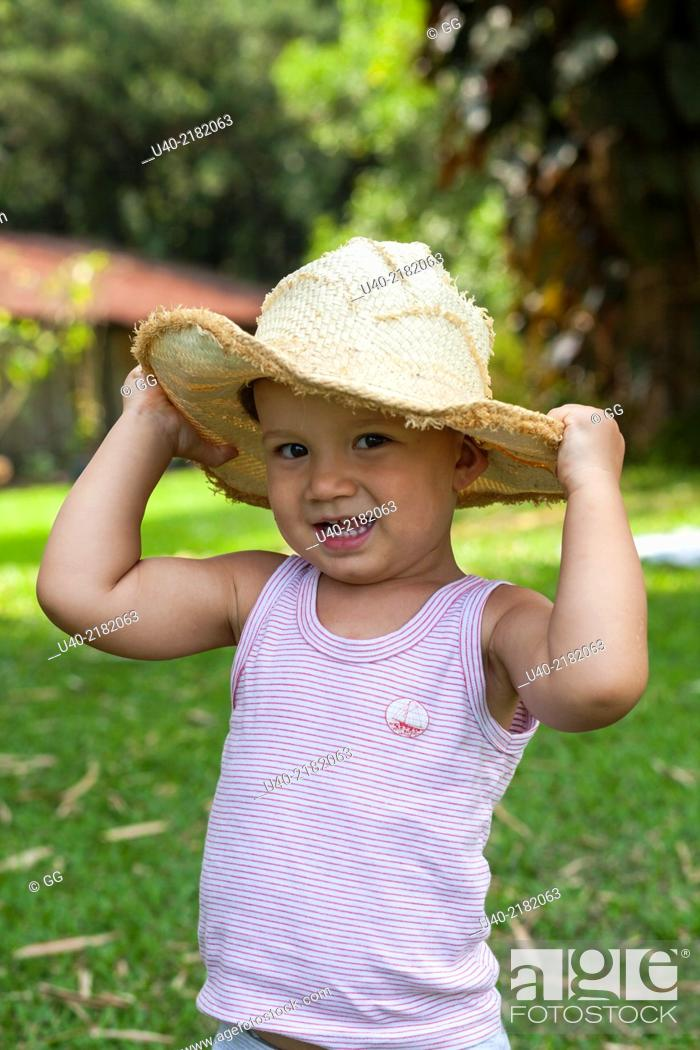Stock Photo - 2 year old boy outdoors with cowboy hat. 7170ffac900