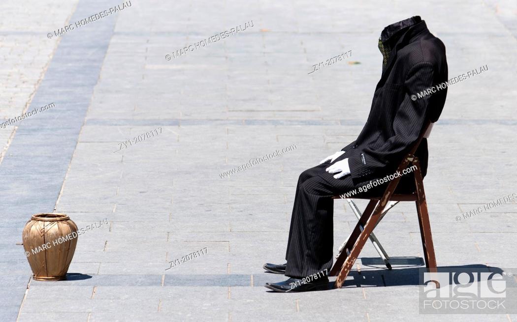 Stock Photo: Headless Man Artist on a street in Madrid.