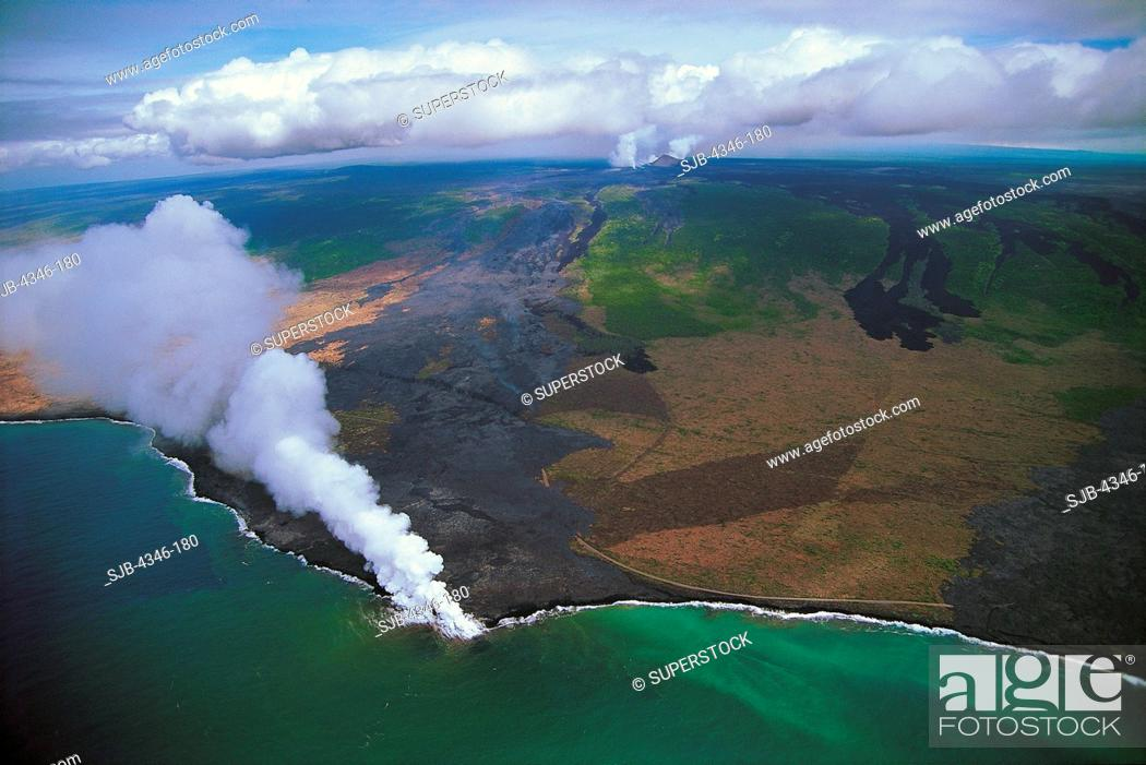 Stock Photo: Aerial View of Kilauea Volcano With Active Pu'u O'o Vent and Lava Entering the Pacific Ocean.