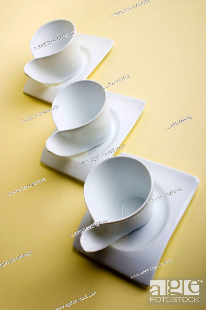 Stock Photo: Three white coffee cups in futuristic design.