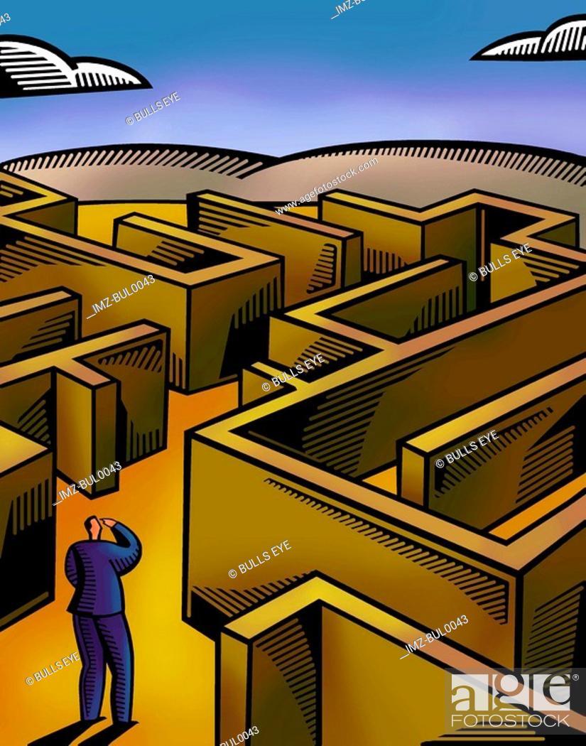 Stock Photo: A businessman walking through a maze.