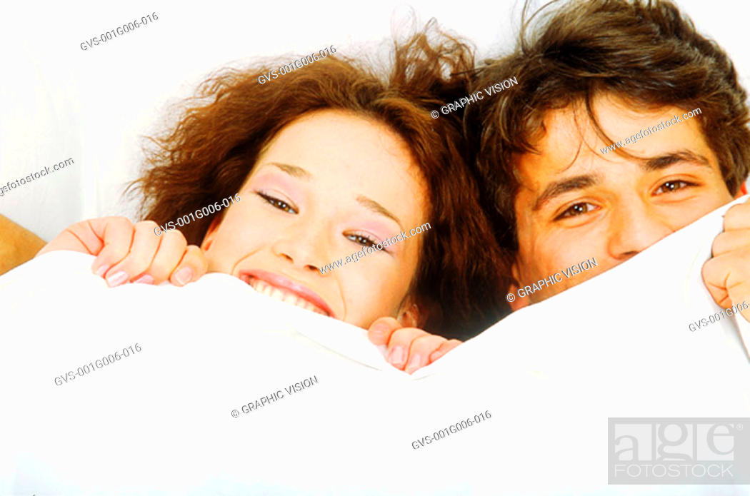 Stock Photo: Close-up of a couple hiding under the sheets.