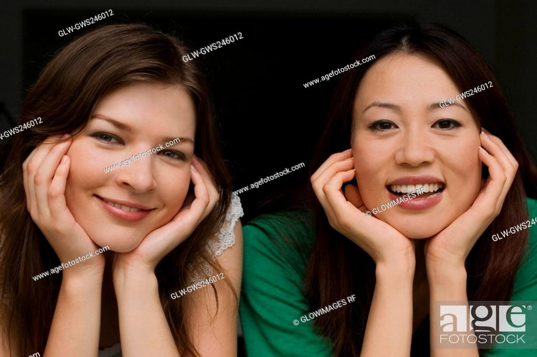 Stock Photo: Portrait of two young women smiling.