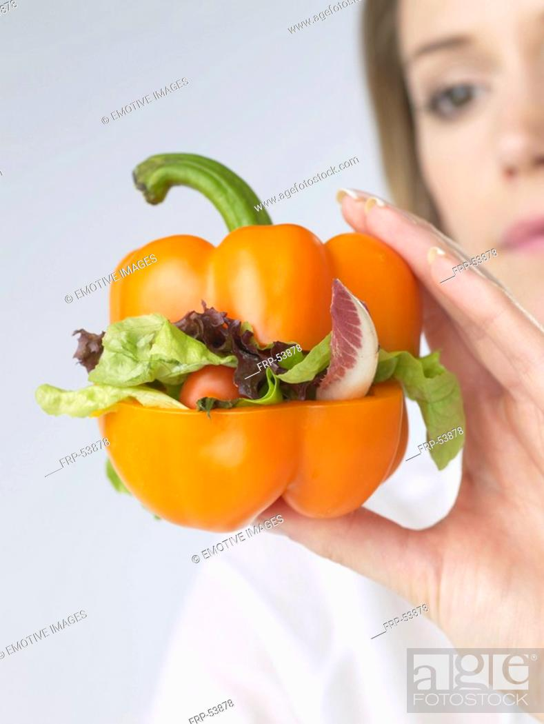 Stock Photo: Woman with pepper vegetable-burger.