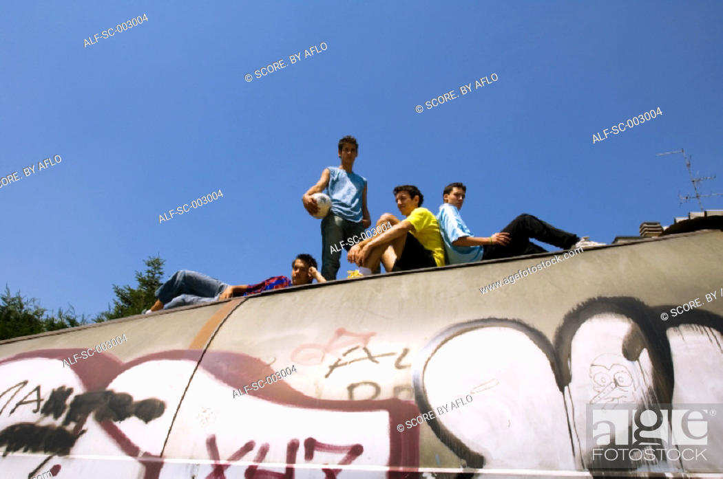 Stock Photo: Teenage boys on top of tunnel.