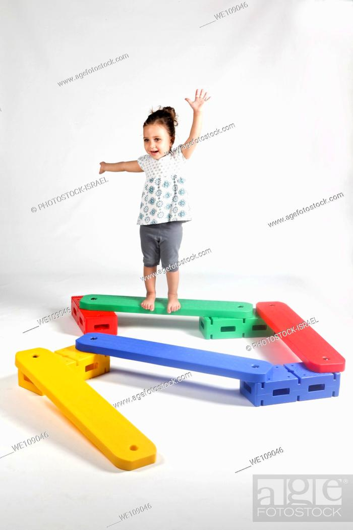 Stock Photo: Indoor playground young girl of 4 balances On white Background MR available.