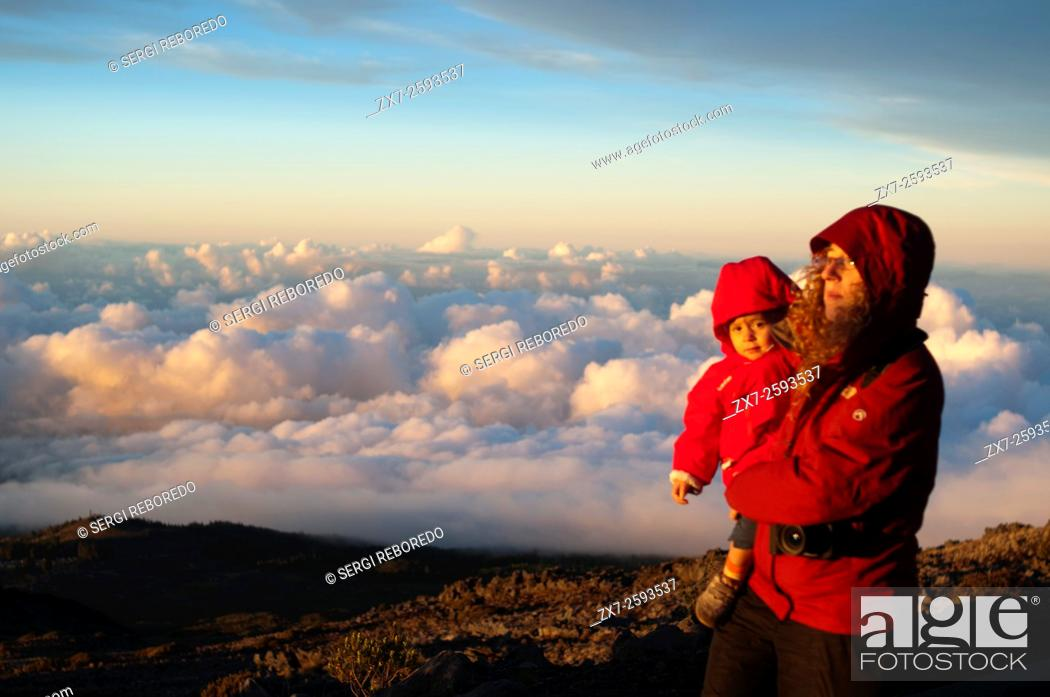 Stock Photo: Mother wirh her daughter in Haleakala National Park. Views from the viewpoint of Leleiwi. Maui. Hawaii. Asian tourists enjoy seeing their shadows on the clouds.