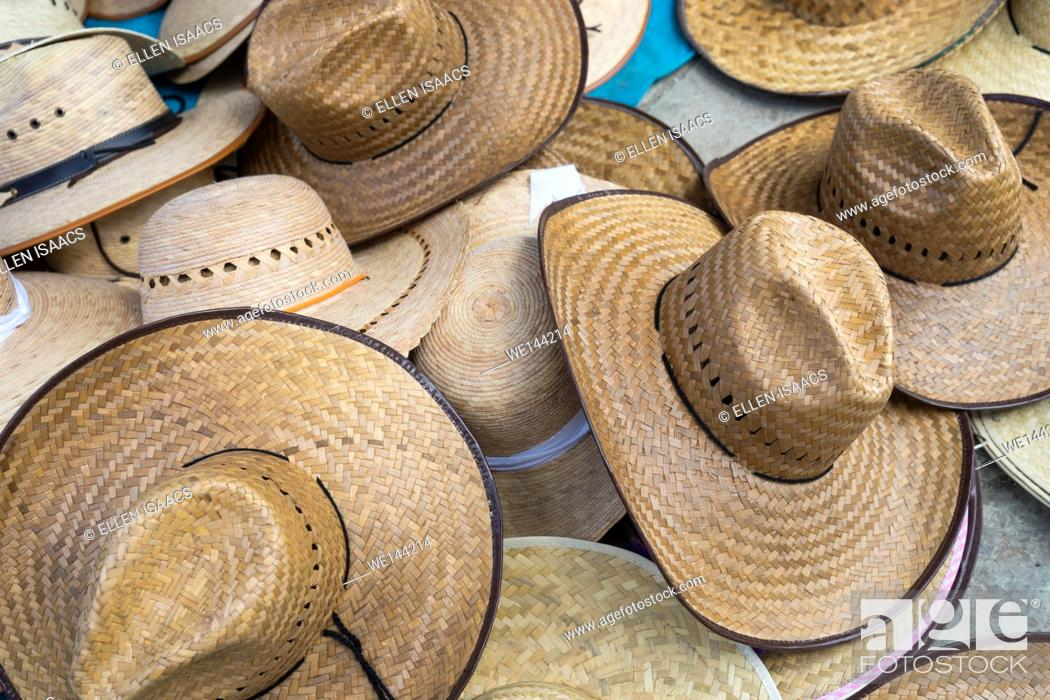 Stock Photo: Assortment of straw hats on display at a Mexican market.