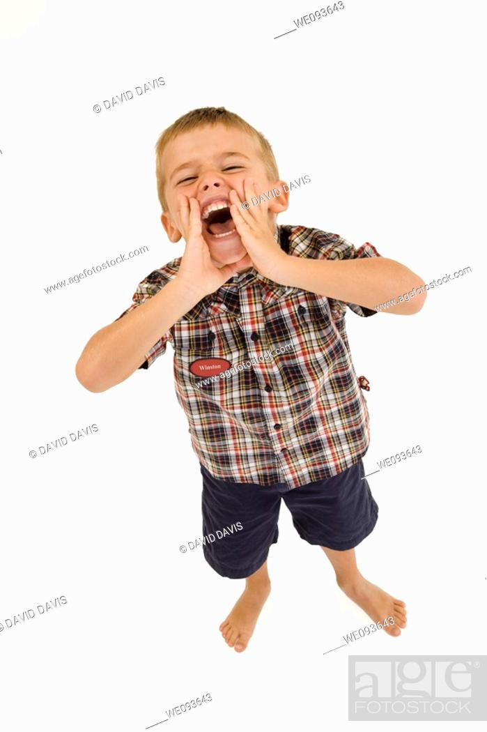 Stock Photo: Six year old boy standing on white background shouting and wearing casual clothes.