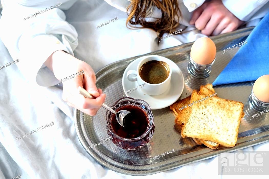 Stock Photo: Breakfast in bed in hotel. Redhead gird after taking shower has a breakfast in bed in hotel room.