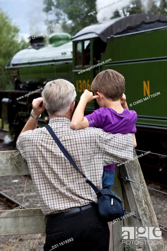 Stock Photo: Young and old railway enthusiasts.