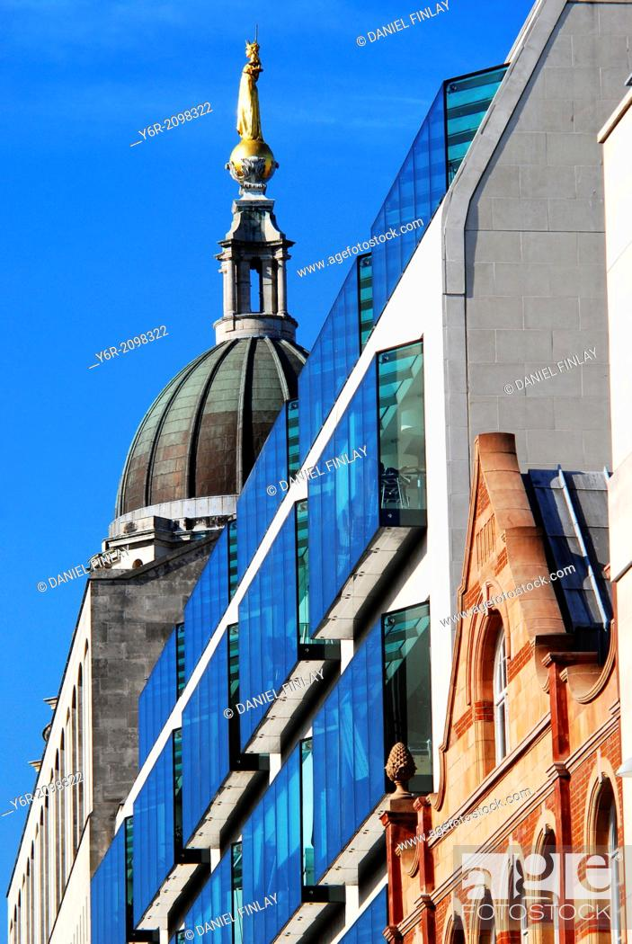 Stock Photo: Modern architecture in the City of London business quarter, with the dome of the famous Old Bailey or Central Criminal Court and its figure of ''Justice'' in.