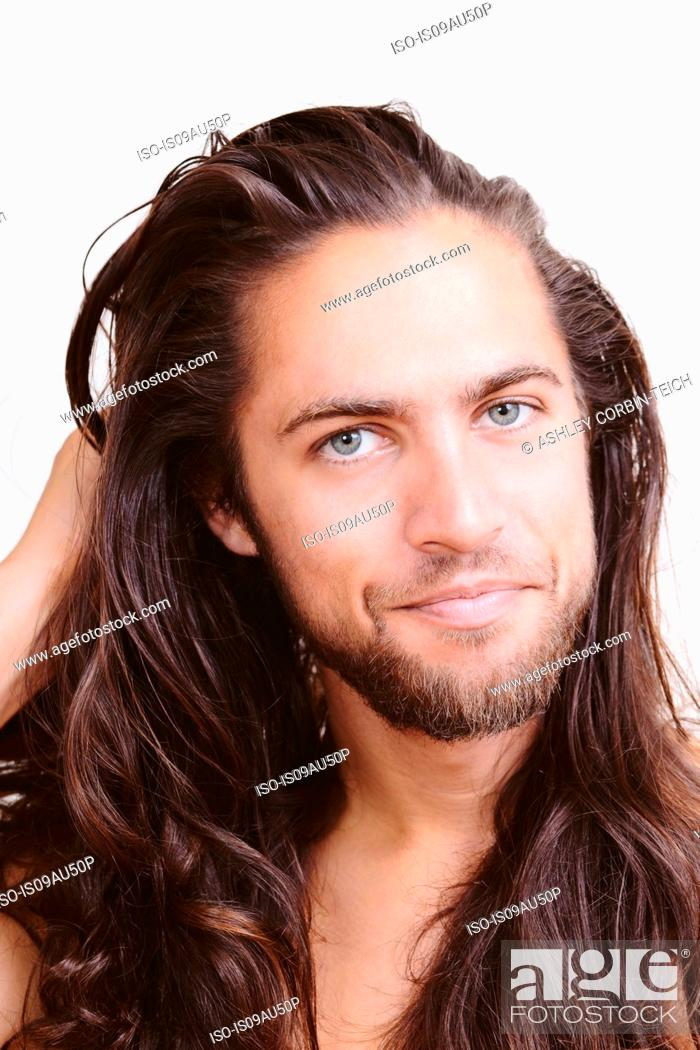 Stock Photo: Portrait of young man with long hair, close-up.