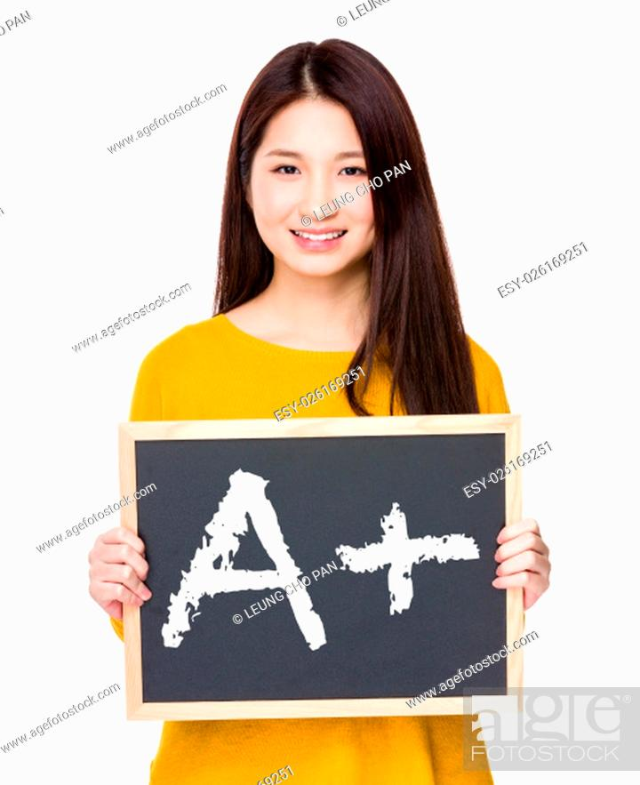 Stock Photo: Woman hold blackboard showing sign of A plus.
