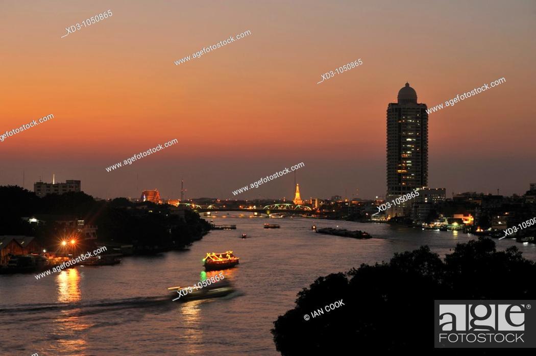 Stock Photo: view north along Chao Phraya River from Chinatown area, Bangkok, Thailand.