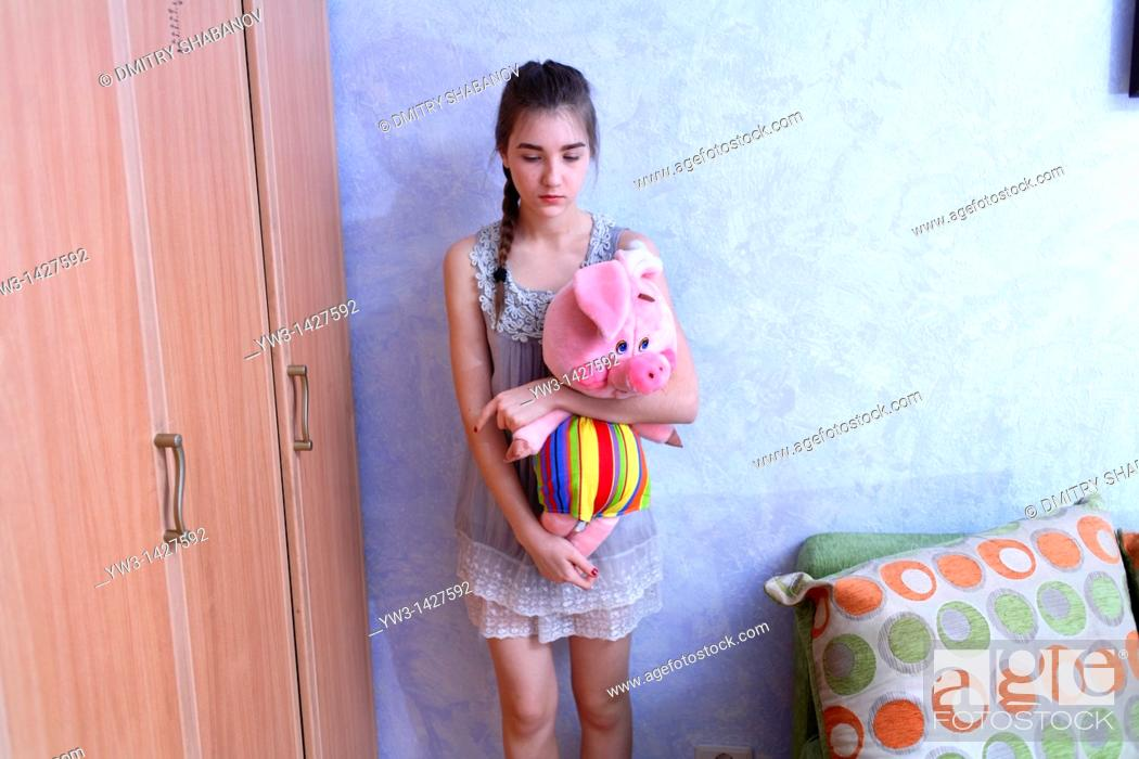 Stock Photo: Beautiful Blond girl with her Plush Pig.