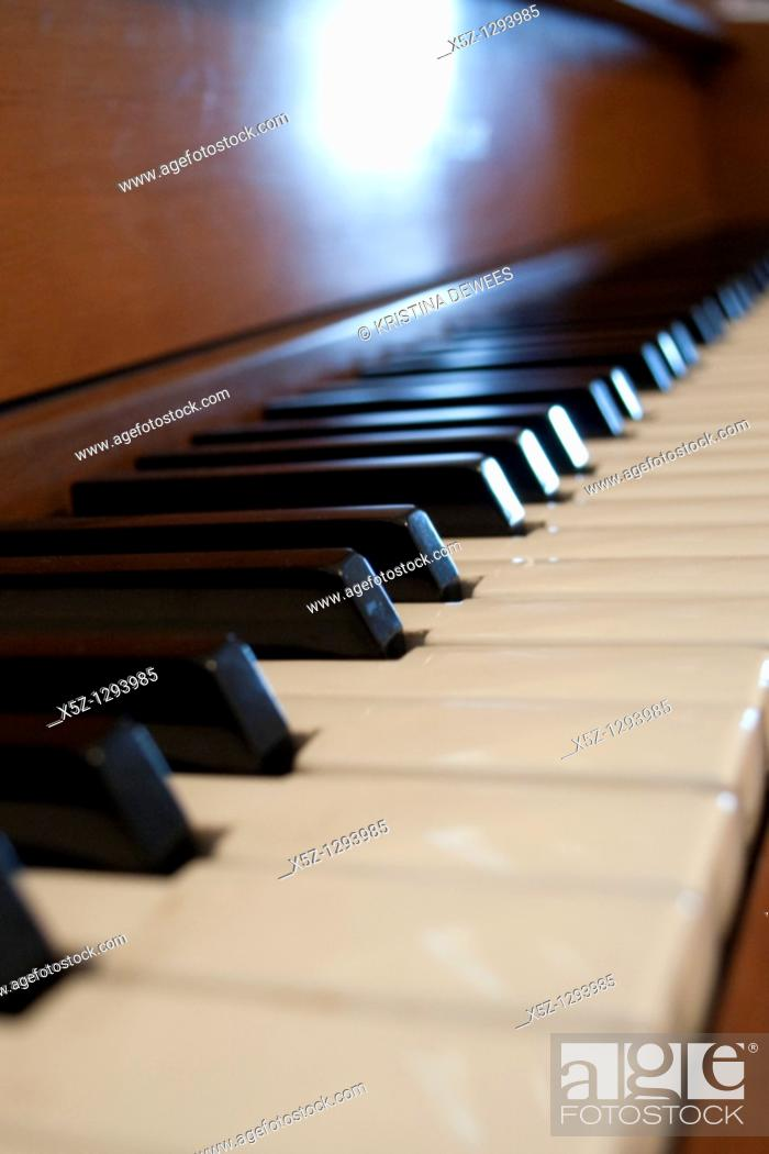 Stock Photo: The keys of an old Piano in the light.