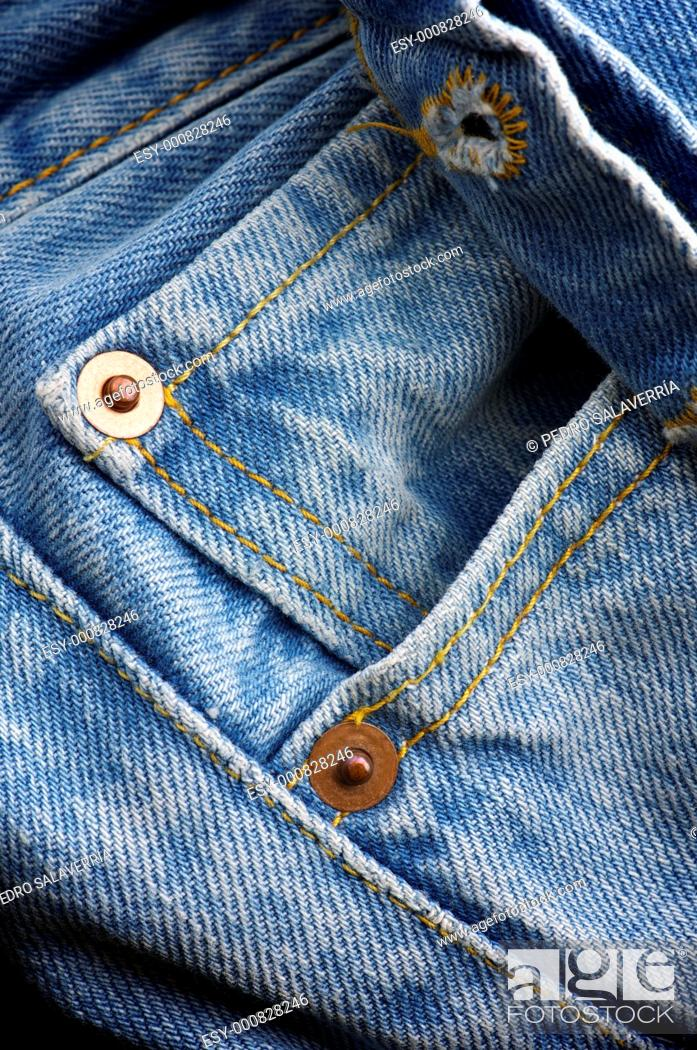 Stock Photo: Pocket and close buttonhole closure of a blue jeans.