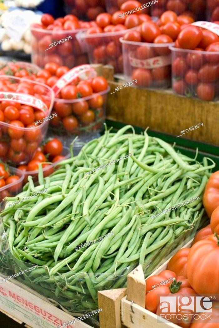 Stock Photo: Green beans and tomatoes at a market.
