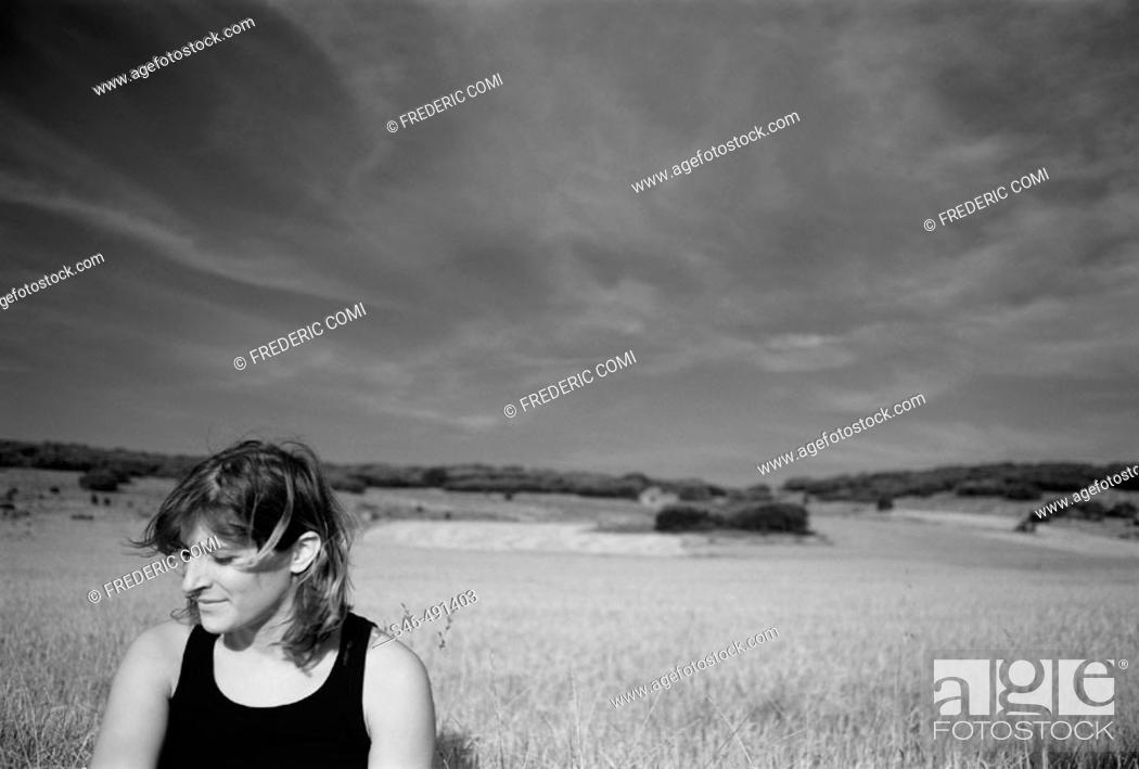 Stock Photo: Woman in field.