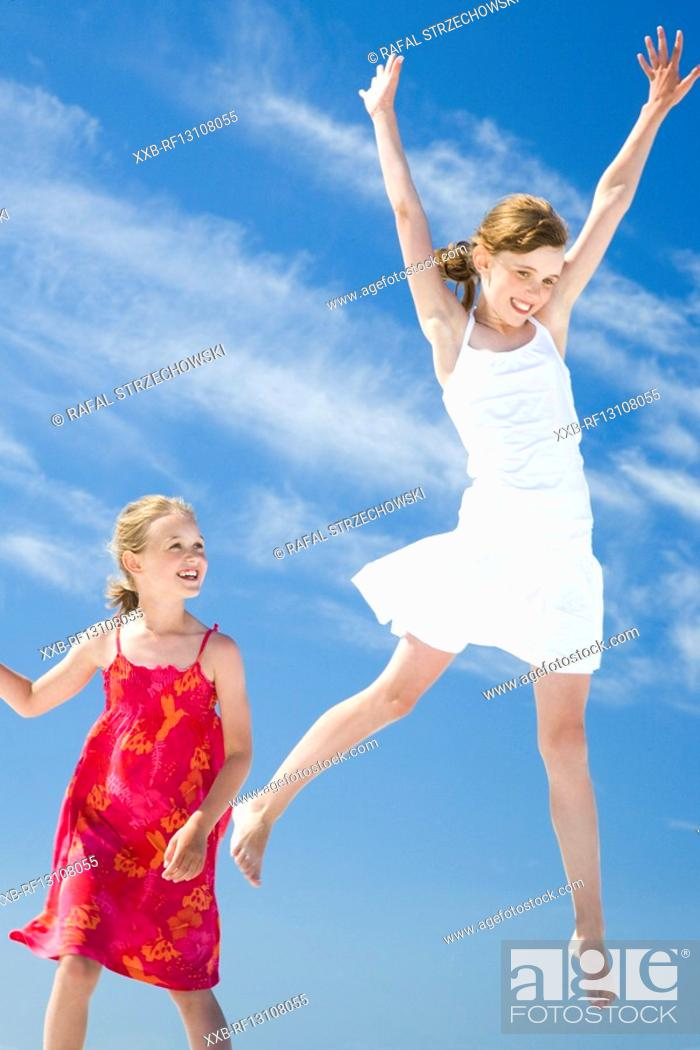 Stock Photo: jumping girls.