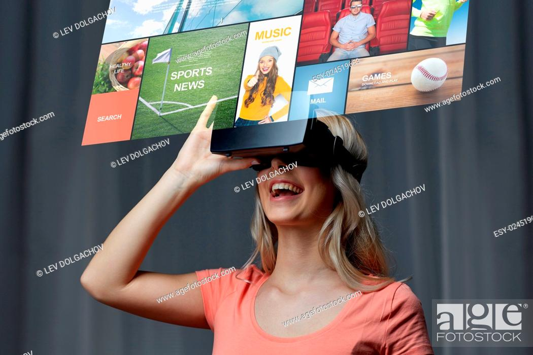 Stock Photo: technology, virtual reality, cyberspace, entertainment and people concept - happy young woman with virtual reality headset or 3d glasses at home looking at news.