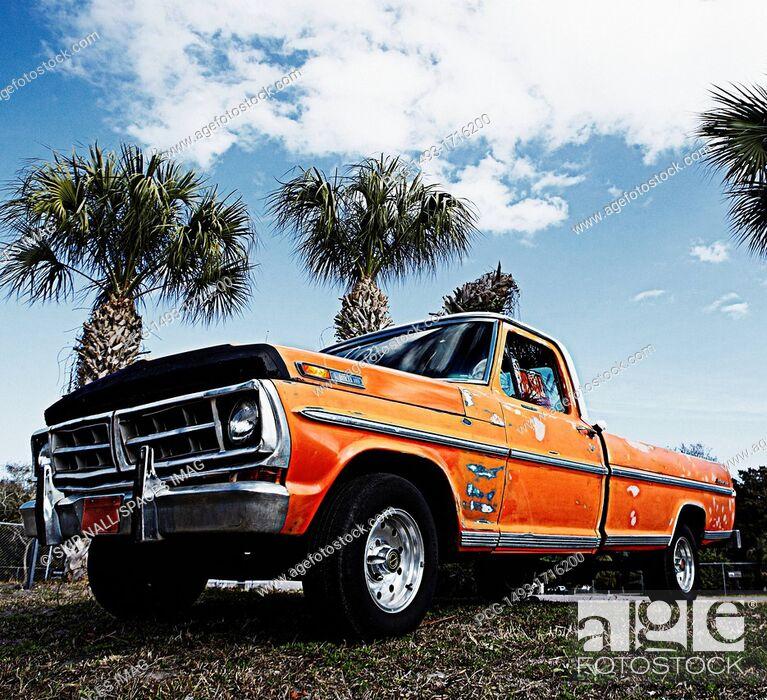 Stock Photo: Weathered Orange Truck.