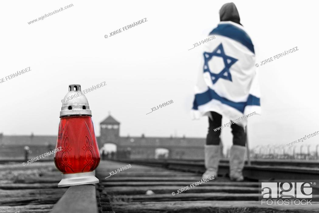 Stock Photo: Israeli girl with a flag looking at the gates of the Auschwitz-Birkenau concentration camp, Poland, Europe.