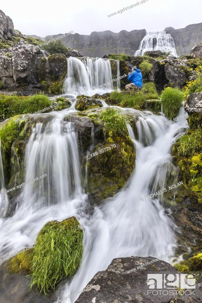 Stock Photo: Photographer at Dynjandi, Fjallfoss, a series of waterfalls located in the Westfjords, Iceland.