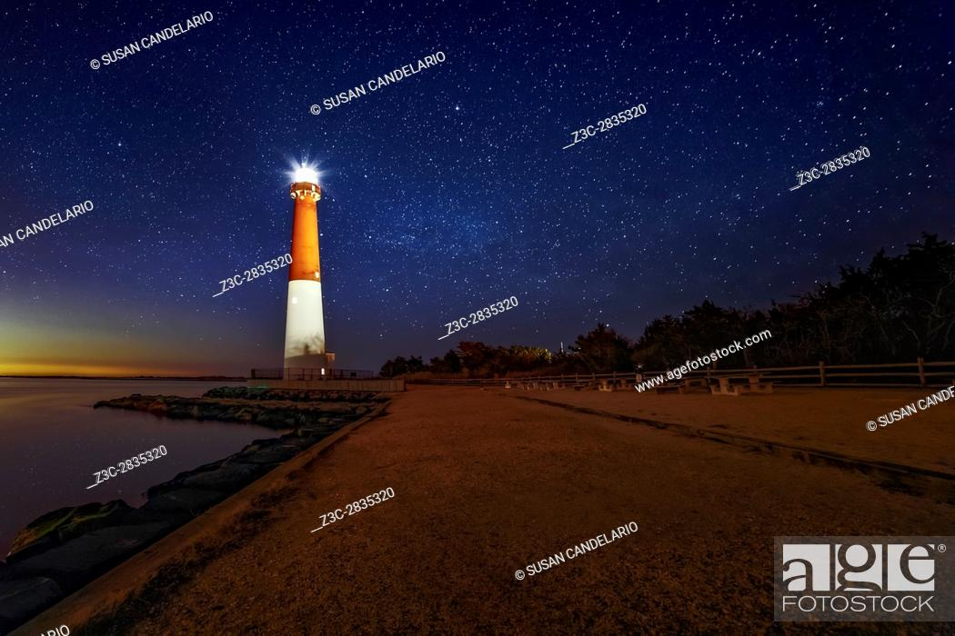 Stock Photo: Barnegat Lighthouse Under The Stars - A beautiful star filled sky at. Barnegat Lighthouse State Park located on the northern tip of Long Beach Island in Ocean.