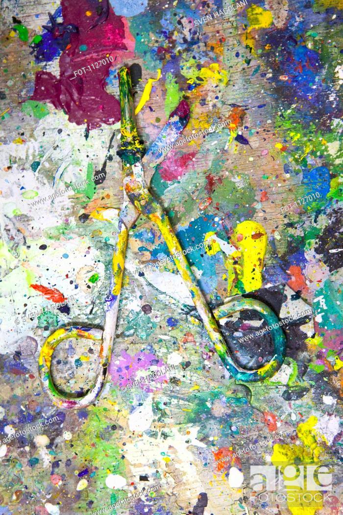 Stock Photo: Splattered paint on scissors.