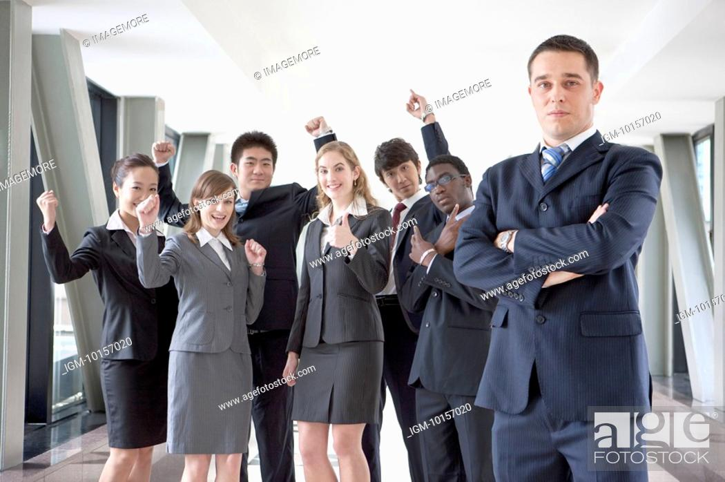 Stock Photo: Business people standing and gesturing to be successful with smile together.
